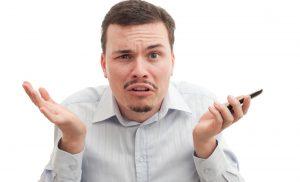 Man Choosing Between Mobile Blackjack and Mobile Roulette