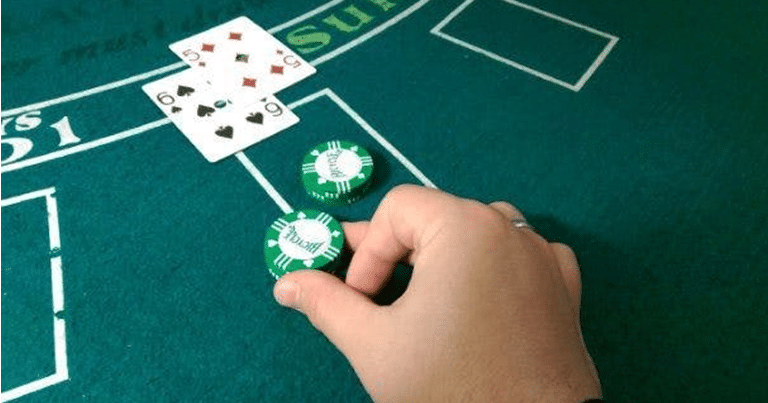 Player Doubling Down Move in Game of Blackjack - Blackjack Table with Casino Chips