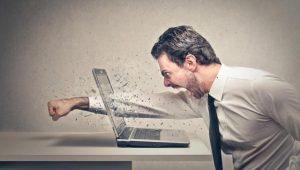 Angry Man Punching Laptop
