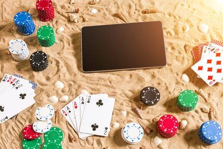 Casino Chips and Cards on Beach