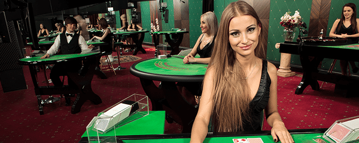Live Casino Croupiers Standing At Tables