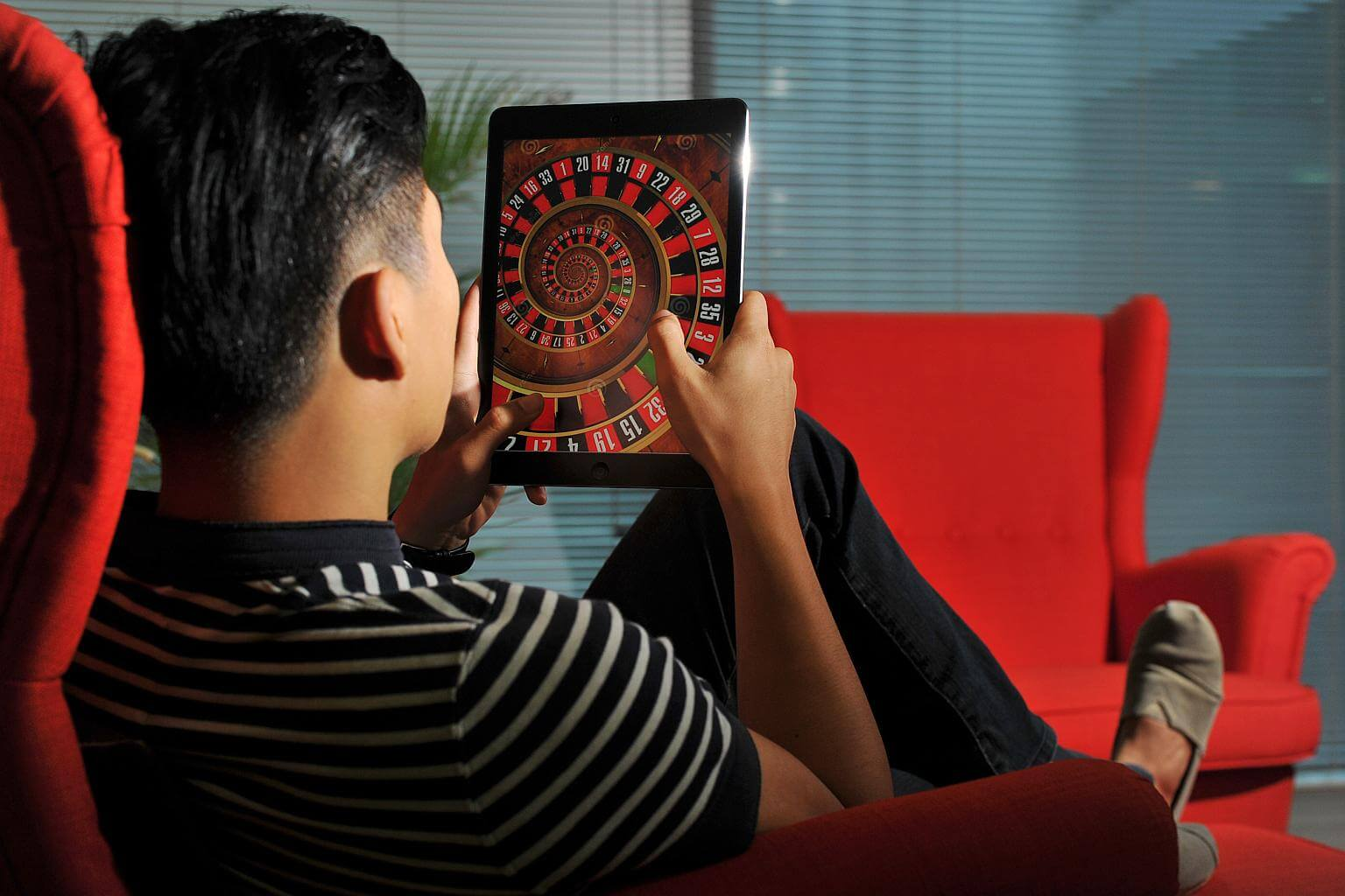 Man Playing Roulette On Tablet