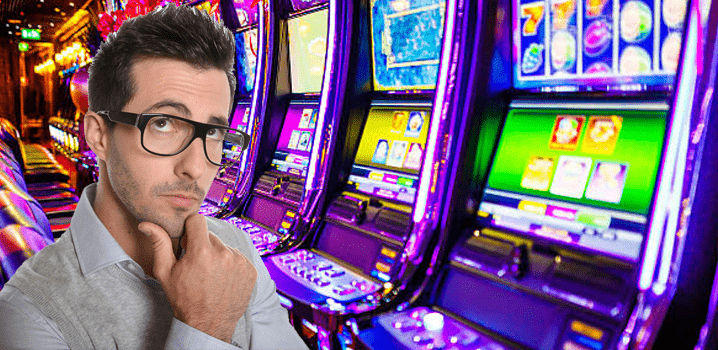 Man With Thining Face Infront Of Land Based Casino Slot Machines