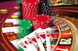 Mix Of Roulette Wheel, Casino Table, Casino Chips And Playing Cards