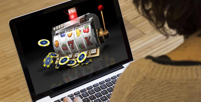 Woman Playing On Laptop With Animated Slot Machine On Screen