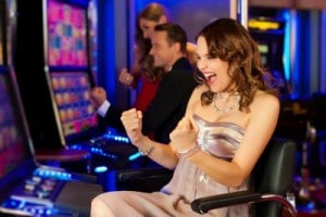excited woman playing slot machine