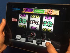 Playing Video Slot Game on Tablet