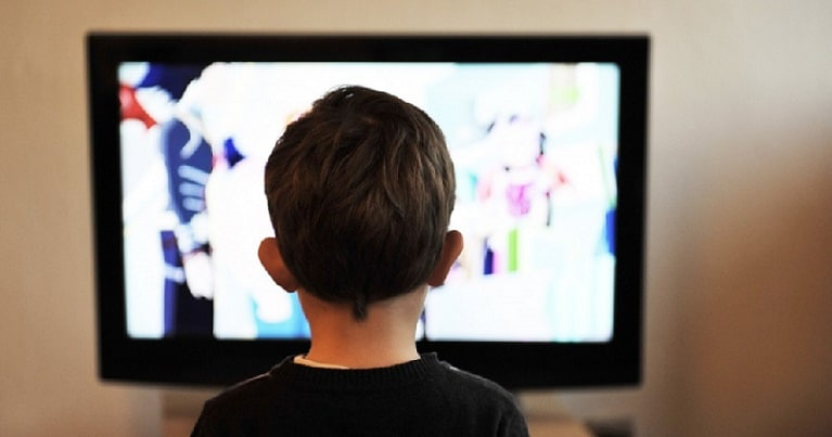 Child Stood in Front of TV Screen