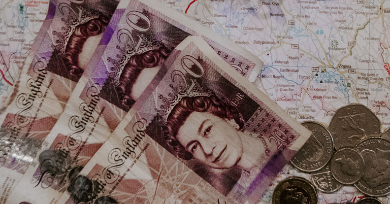20 pound bank notes on map